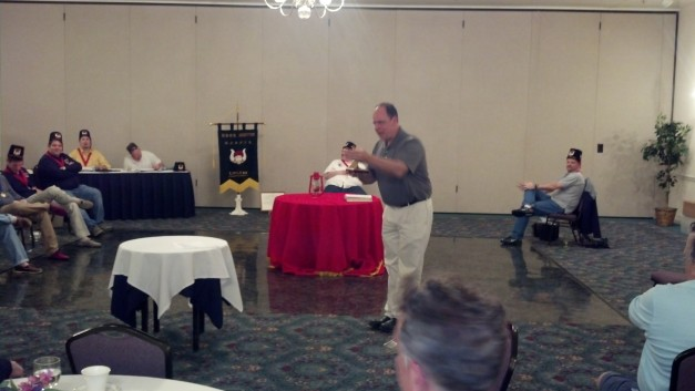 "Pro. Andrew ""the Auctioneer"" Sterling drives the bidding for the Grand Master's Medallions at our latest meeting."